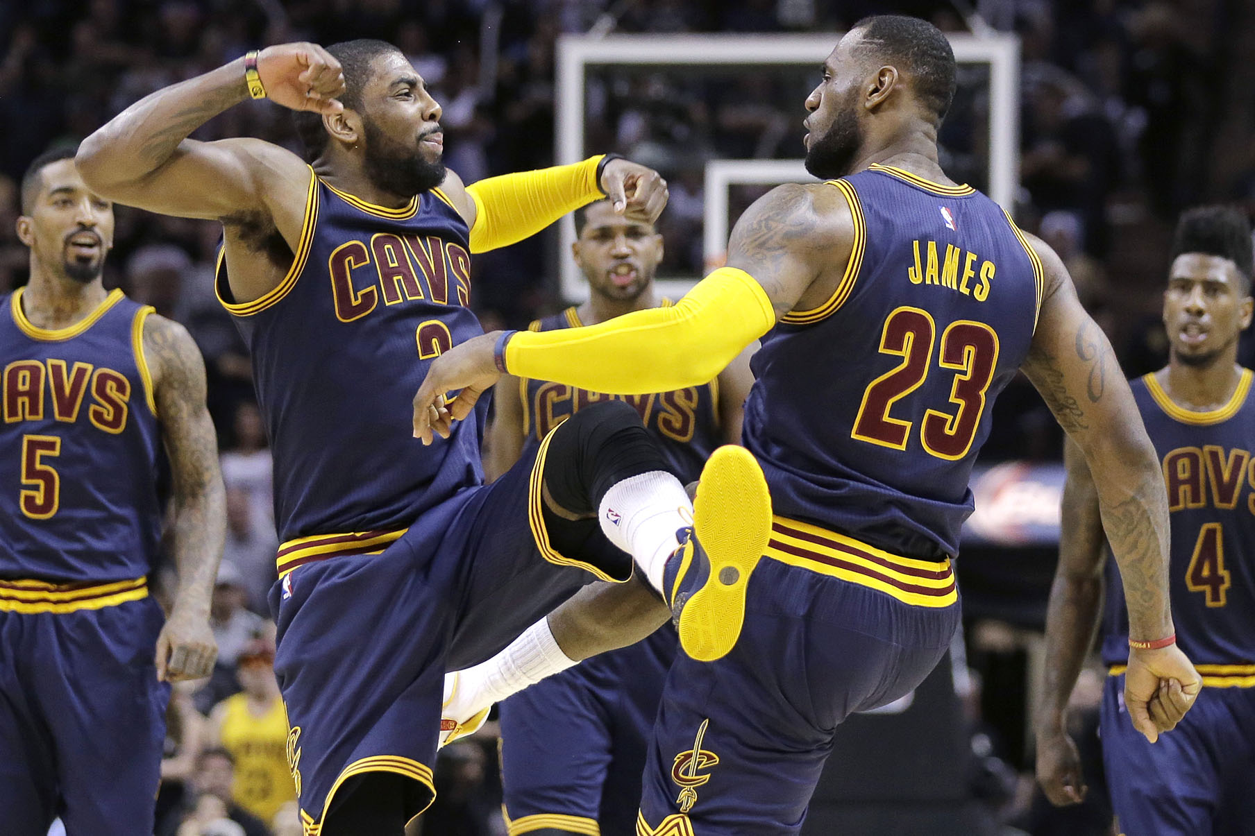 Cleveland Cavaliers' Kyrie Irving (2) and LeBron James (23) celebrate during overtime of an NBA basketball game against the San Antonio Spurs, Thursday, March 12, 2015, in San Antonio. Cleveland won 128-125. Irving scored 57 points. (AP Photo/Eric Gay)